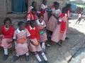 Grapesyard-school-girls-enjoy-hot-lunch